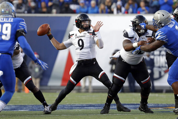 Cincinnati quarterback Desmond Ridder (9) passes against Memphis during the first half of an NCAA college football game for the American Athletic Conference championship Saturday, Dec. 7, 2019, in Memphis, Tenn. (AP Photo/Mark Humphrey)
