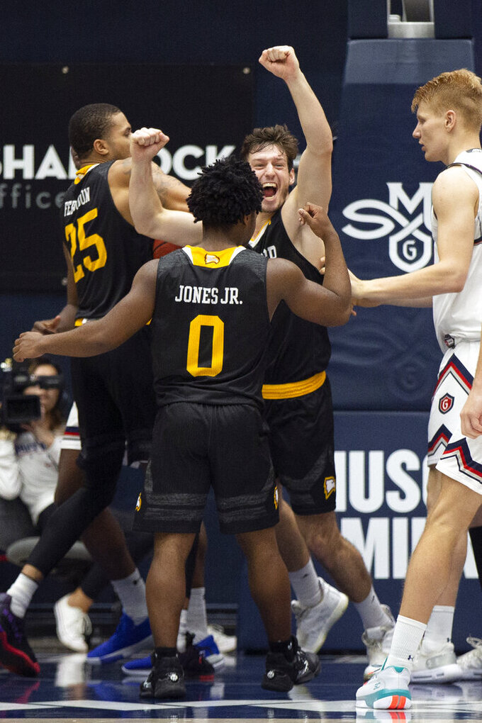 Winthrop players celebrate as the final horn sounds during the second half of an NCAA college basketball game against Saint Mary's, Monday, Nov. 11, 2019 in Moraga, Calif. Winthrop upset 18th-ranked Saint Mary's 61-59. (AP Photo/D. Ross Cameron)