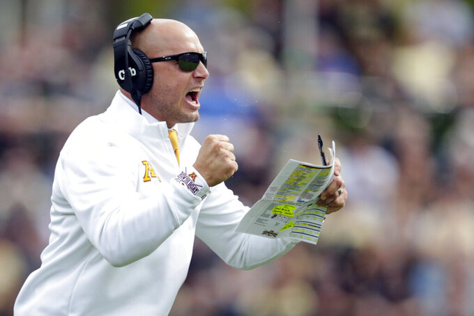 FILE - In this Sept. 28, 2019, file photo, Minnesota head coach P.J. Fleck celebrates a touchdown during the first half of an NCAA college football game against Purdue in West Lafayette, Ind. Fleck believes keeping an open line of communication is the key to allowing him to redshirt a player without resistance, and avoid having an athlete make the decision himself. (AP Photo/Michael Conroy, File)