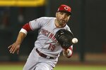Cincinnati Reds first baseman Joey Votto fields a grounder hit by Arizona Diamondbacks' Ketel Marte before tossing to first base for the out during the first inning of a baseball game, Saturday, Sept. 14, 2019, in Phoenix. (AP Photo/Ross D. Franklin)