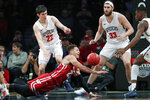 Wisconsin guard Kobe King (23) trips and loses control of the ball with Richmond guard Andre Gustavson (22) and forward Grant Golden (33) watching during the second half of an NCAA college basketball game in the Legends Classic, Monday, Nov. 25, 2019, in New York. Richmond defeated Wisconsin 62-52. (AP Photo/Kathy Willens)