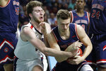 Gonzaga's Drew Timme, left, and Saint Mary's Kristers Zoriks battle for the ball in the first half of an NCAA college basketball game in the final of the West Coast Conference men's tournament Tuesday, March 10, 2020, in Las Vegas. (AP Photo/John Locher)