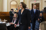Former White House national security aide Fiona Hill, and David Holmes, a U.S. diplomat in Ukraine, back right, walk to their seats to testify before the House Intelligence Committee on Capitol Hill in Washington, Thursday, Nov. 21, 2019, during a public impeachment hearing of President Donald Trump's efforts to tie U.S. aid for Ukraine to investigations of his political opponents. (AP Photo/Manuel Balce Ceneta)