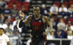 UNLV's Cheikh Mbacke Diong gestures after scoring during the first half of the team's NCAA college basketball game against San Diego State in the Mountain West Conference men's tournament Thursday, March 14, 2019, in Las Vegas. (AP Photo/Isaac Brekken)