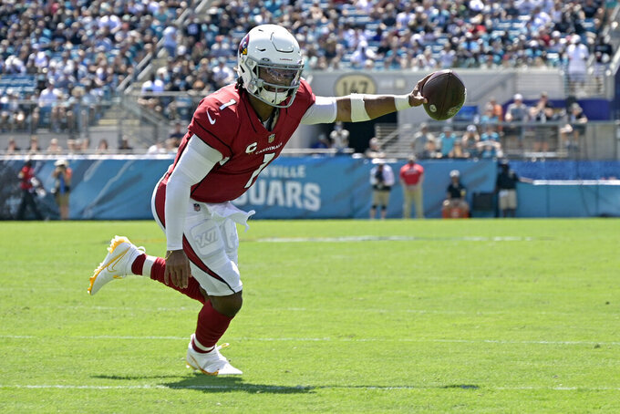 Arizona Cardinals quarterback Kyler Murray scores a touchdown against the Jacksonville Jaguars on the 1-yard run during the first half of an NFL football game, Sunday, Sept. 26, 2021, in Jacksonville, Fla. (AP Photo/Phelan M. Ebenhack)