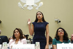 Rep. Alexandria Ocasio-Cortez, D-NY., stands to be sworn in before she testifies before the House Oversight Committee hearing on family separation and detention centers, Friday, July 12, 2019 on Capitol Hill in Washington. Rep. Veronica Escobar, D-Texas, is left and Rep. Rashida Tlaib, D-Mich., right. (AP Photo/Pablo Martinez Monsivais)