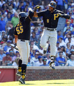 Pittsburgh Pirates' Starling Marte, right, celebrates with Josh Bell, left, after hitting three-run home run against the Chicago Cubs during the eighth inning of a baseball game, Friday, July 12, 2019, in Chicago. (AP Photo/Kamil Krzaczynski)
