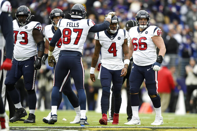 Houston Texans tight end Darren Fells (87) taps quarterback Deshaun Watson (4) after Watson lost a fumble on a sack against the Baltimore Ravens during the first half of an NFL football game, Sunday, Nov. 17, 2019, in Baltimore. (AP Photo/Gail Burton)