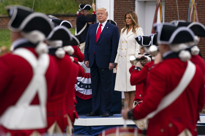President Donald Trump and first lady Melania Trump participate in a Memorial Day ceremony at Fort McHenry National Monument and Historic Shrine, Monday, May 25, 2020, in Baltimore. (AP Photo/Evan Vucci)