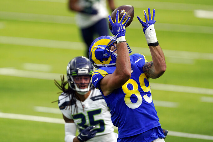 Los Angeles Rams tight end Tyler Higbee (89) makes a catch in front of Seattle Seahawks strong safety Ryan Neal during the first half of an NFL football game Sunday, Nov. 15, 2020, in Inglewood, Calif. (AP Photo/Ashley Landis)
