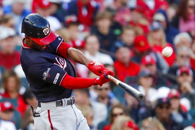 FILE - In this Oct. 12, 2019, file photo, Washington Nationals' Michael A. Taylor hits a home run during the third inning of Game 2 of the baseball National League Championship Series against the St. Louis Cardinals in St. Louis. Taylor and the Nationals agreed Thursday, Jan. 9, 2020, to a one-year contract for $3,325,000, up slightly from his $3.25 million salary last season, when the outfielder lost an arbitration hearing. (AP Photo/Jeff Roberson, File)