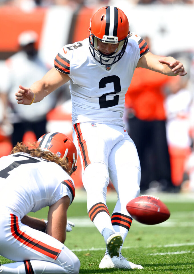 Cleveland Browns kicker Cody Parkey (2) boots an extra point in the first quarter of an NFL preseason football game against the New York Giants, Sunday, Aug. 22, 2021, in Cleveland. Parkey is being placed on injured reserve, meaning Chase McLaughlin will likely begin the season as Cleveland's starter. Parkey sustained a quadriceps injury during the exhibition win over the Giants on Sunday. (AP Photo/David Richard)