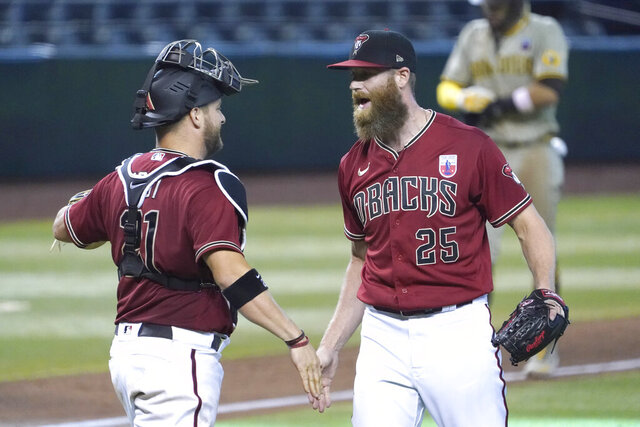 Arizona Diamondbacks pitcher Archie Bradley, right, and Stephen Vogt, left, celebrate after defeating the San Diego Padres in a baseball game, Sunday, Aug 16, 2020, in Phoenix. (AP Photo/Rick Scuteri)