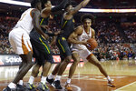 Texas forward Jericho Sims, right, is pressured by Baylor guard Mark Vital, second from right, and forward Freddie Gillespie, second from left, during the second half of an NCAA college basketball game, Monday, Feb. 10, 2020, in Austin, Texas. (AP Photo/Eric Gay)