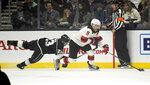 Los Angeles Kings right wing Dustin Brown, left, dives for the puck as New Jersey Devils left wing Taylor Hall takes it from him during the first period of an NHL hockey game Thursday, Dec. 6, 2018, in Los Angeles. (AP Photo/Mark J. Terrill)