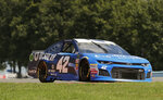 Kyle Larson (42) makes his way around the course during practice for a NASCAR Cup series auto race, Saturday, Aug. 4, 2018, in Watkins Glen, N.Y. (AP Photo/Julie Jacobson)