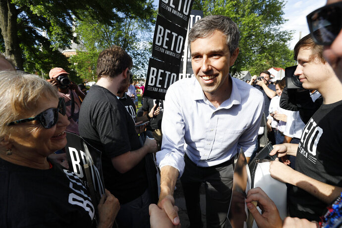 Democratic presidential candidate former Texas Congressman Beto O'Rourke greets supporters before walking in the Independence Fourth of July parade, Thursday, July 4, 2019, in Independence, Iowa. (AP Photo/Charlie Neibergall)