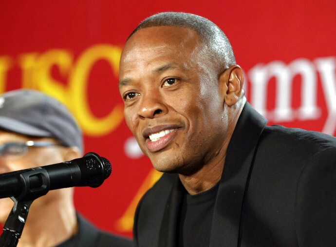 FILE - This May 15, 2013 file photo shows hip-hop mogul Dr. Dre as he announces a $70 million dollar donation to create the new