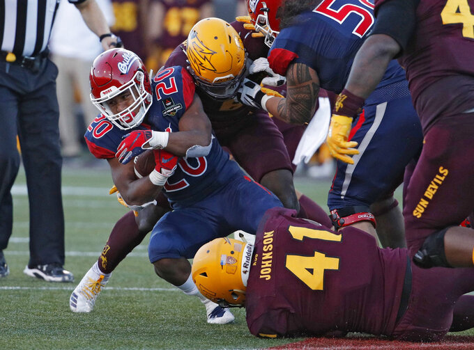 Fresno State running back Ronnie Rivers (20) is tackled after running for a gain against Arizona State during the second half of the Las Vegas Bowl NCAA college football game, Saturday, Dec. 15, 2018, in Las Vegas. (AP Photo/John Locher)
