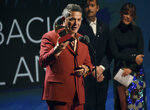 Alejandro Sanz accepts the award for record of the year for