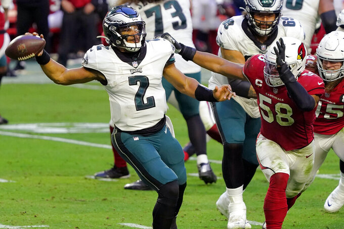 Philadelphia Eagles quarterback Jalen Hurts (2) throws under pressure from Arizona Cardinals middle linebacker Jordan Hicks (58) during the second half of an NFL football game, Sunday, Dec. 20, 2020, in Glendale, Ariz. (AP Photo/Rick Scuteri)