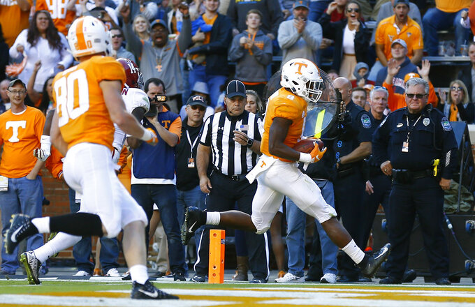 Tennessee running back Ty Chandler (8) scores a touchdown in the first half of an NCAA college football game against Alabama Saturday, Oct. 20, 2018, in Knoxville, Tenn. (AP Photo/Wade Payne)