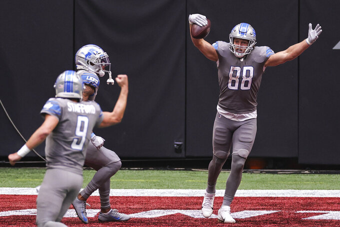 Detroit Lions tight end T.J. Hockenson (88) celebrates a touchdown in an NFL game against the Atlanta Falcons, Sunday, Oct. 25, 2020 in Atlanta. The Lions defeated the Falcons 23-22.(Margaret Bowles via AP)
