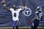 Baltimore Ravens quarterback Lamar Jackson (8) celebrates after scoring a touchdown on a 48-yard run against the Tennessee Titans in the first half of an NFL wild-card playoff football game Sunday, Jan. 10, 2021, in Nashville, Tenn. At right is Titans cornerback Kristian Fulton (26). (AP Photo/Mark Zaleski)