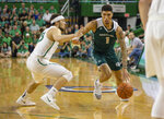 Green Bay's Sandy Cohen (1) pushes up the floor against Marshall's Jarrod West (13) in the championship game of the CollegeInsider.com Tournament on Thursday, April 4, 2019, in Huntington, W.Va.  (Sholten Singer/The Herald-Dispatch via AP)
