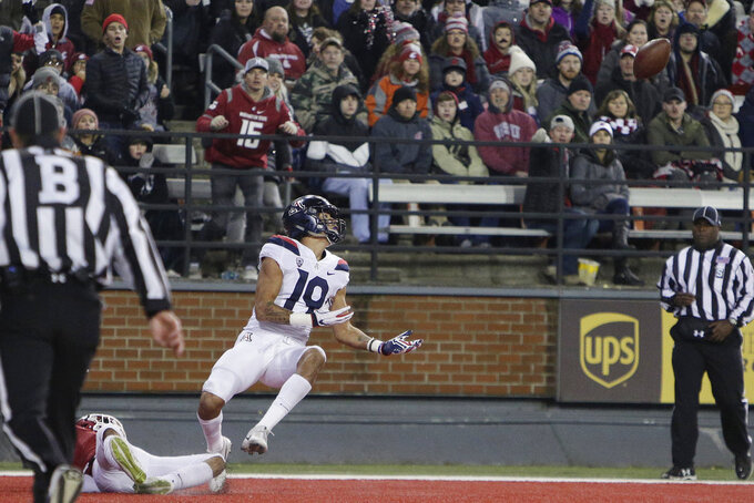 Arizona wide receiver Shawn Poindexter, right, looks at the ball before catching a pass for a touchdown, next to Washington State cornerback Darrien Molton during the first half of an NCAA college football game in Pullman, Wash., Saturday, Nov. 17, 2018. (AP Photo/Young Kwak)