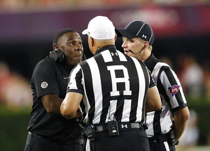 Vanderbilt coach Derek Mason talks with officials during the first half of the teams NCAA college football game against Georgia on Saturday, Oct. 6, 2018, in Atlanta. (AP Photo/John Bazemore)