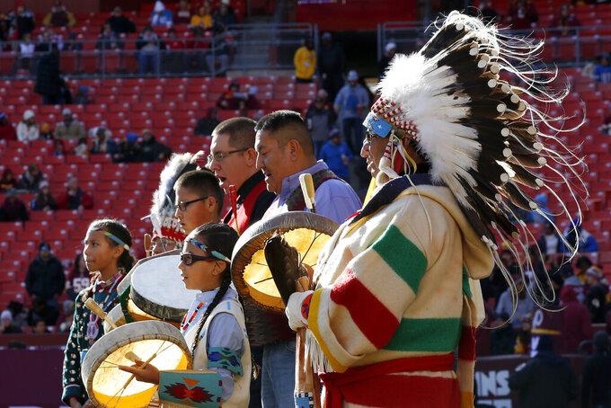 Members of the Blackfeet National perform as part of the Washington Redskins' observance of Native American Heritage Month prior to an NFL football game between the Redskins and the Detroit Lions, Sunday, Nov. 24, 2019, in Landover, Md. (AP Photo/Alex Brandon)