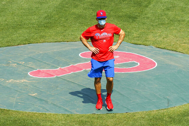 FILE - In this July 3, 2020, file photo, Philadelphia Phillies manager Joe Girardi looks on from the pitchers mound during a baseball training session in Philadelphia. (AP Photo/Chris Szagola, File)