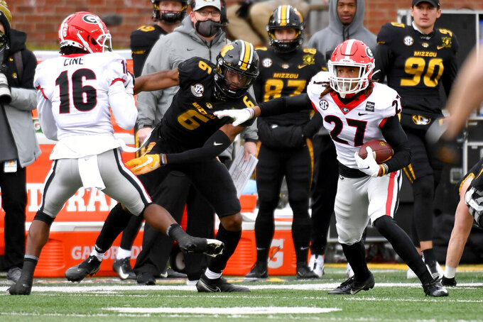 Georgia defensive back Eric Stokes (27) runs with the ball after intercepting a pass intended for Missouri wide receiver Keke Chism (6) during the first half of an NCAA college football game Saturday, Dec. 12, 2020, in Columbia, Mo. (AP Photo/L.G. Patterson)