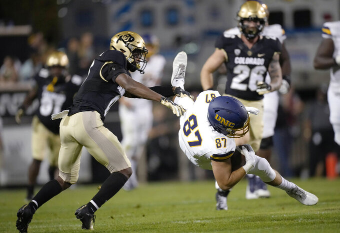 Colorado safety Chris Miller, left, sends Northern Colorado tight end Darren DeLaCroix to the turf during the second half of an NCAA college football game Friday, Sept. 3, 2021, in Boulder, Colo. Colorado won 35-7. (AP Photo/David Zalubowski)