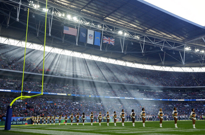 FILE - In this Oct. 21, 2018, file photo, cheerleaders line up before an NFL football game between Tennessee Titans and the Los Angeles Chargers at Wembley Stadium in London. As the league celebrates its 100th season, it continues to expand its foreign footprint with five international games in 2019. Four are in London, including two at Wembley Stadium, and the league returns to Mexico. (AP Photo/Matt Dunham, File)