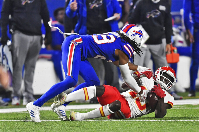 Buffalo Bills' Josh Norman, left, brings down Kansas City Chiefs' Tyreek Hill during the second half of an NFL football game, Monday, Oct. 19, 2020, in Orchard Park, N.Y. (AP Photo/Adrian Kraus)