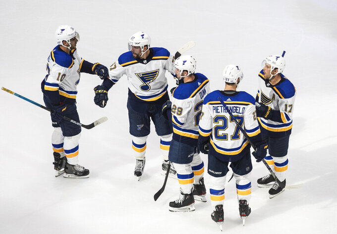 St. Louis Blues players celebrate a goal against the Vancouver Canucks during the second period of an NHL Western Conference Stanley Cup playoff series, in Edmonton, Alberta, Friday, Aug. 21, 2020. (Jason Franson/The Canadian Press via AP)