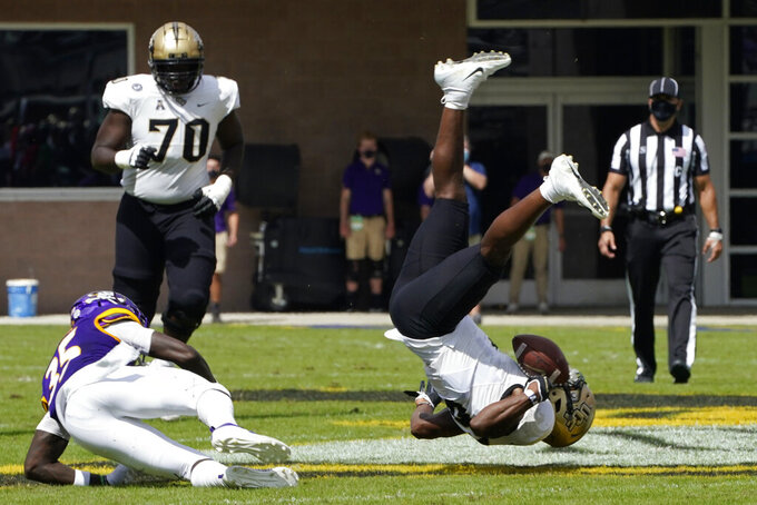 Central Florida wide receiver Marlon Williams is upended on a hit by East Carolina defensive back Jireh Wilson (35) during the first half of an NCAA college football game in Greenville, N.C., Saturday, Sept. 26, 2020. (AP Photo/Gerry Broome)