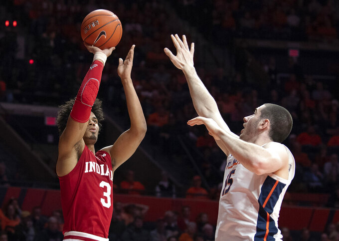 Indiana forward Justin Smith (3) shoots against Illinois forward Giorgi Bezhanishvili (15) during the second half of an NCAA college basketball game in Champaign, Ill., Thursday, March 7, 2019. (AP Photo/Stephen Haas)