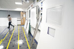 A Covid testing area is constructed at Great Academy Ashton,, as the school prepares for its reopening on March 8 after the latest lockdown curb the spread of coronavirus, in Ashton-Under-Lyne, England, Thursday, March 4, 2021. The school with approximately 1300 pupils aged 11 to 16 in Greater Manchester will have to conduct around 450 tests per day on pupils and staff in the first 2 weeks after the return of students on Monday. (AP Photo Jon Super)