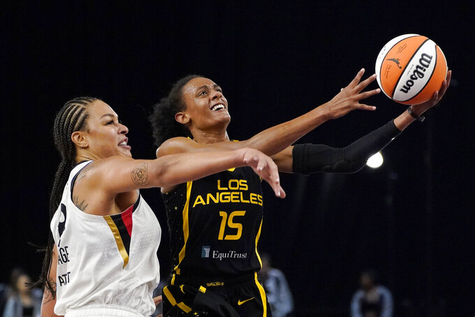 Los Angeles Sparks guard Brittney Sykes, right, shoots as Las Vegas Aces center Liz Cambage defends during the first half of a WNBA basketball game Friday, July 2, 2021, in Los Angeles. (AP Photo/Mark J. Terrill)