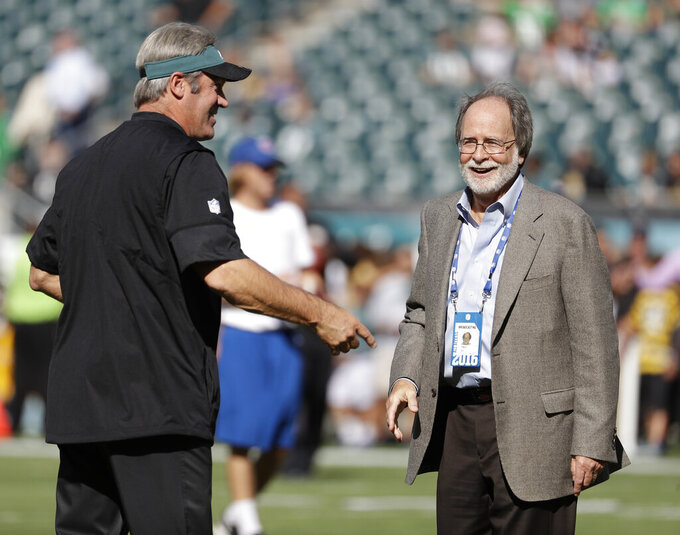 In this Sept. 25, 2016, photo, Howard Katz, right, and Philadelphia Eagles head coach Doug Pederson are seen during an NFL football game against the Pittsburgh Steelers, in Philadelphia. Katz has the most unenviable task in the National Football League. As the league's senior vice president of broadcasting and media operations, he is the point person for formulating the schedule and trying to make the executives of the league's four broadcast partners happy. Before the public got their first look at the upcoming regular-season schedule on Wednesday, April 17, 2019, Katz relayed to Fox, CBS, NBC and ESPN what games they received. (AP Photo/Michael Perez)