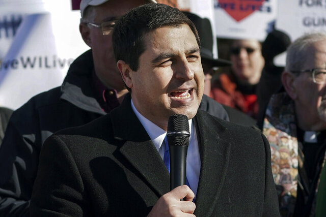 FILE - In this Nov. 7, 2019, file photo, Wisconsin Attorney General Josh Kaul speaks during a rally at the State Capitol in Madison, Wis. Wisconsin's Democratic attorney general filed a lawsuit on Monday, Nov. 23, 2020, together with Gov. Tony Evers, challenging parts of a Republican-authored law limiting their powers that were passed during a lame-duck legislative session two years ago. (Steve Apps/Wisconsin State Journal via AP, File)