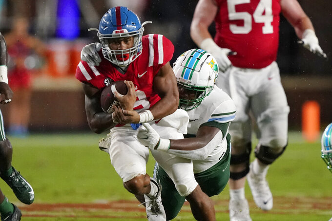 Mississippi running back Jerrion Ealy (9) runs for short yardage as a Tulane player tackles him during the first half of an NCAA college football game, Saturday, Sept. 18, 2021, in Oxford, Miss. (AP Photo/Rogelio V. Solis)