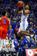 Kentucky's Tyrese Maxey, right, shoots near Florida's Andrew Nembhard (2) in the second half of an NCAA college basketball game in Lexington, Ky., Saturday, Feb. 22, 2020. Kentucky won 65-59. (AP Photo/James Crisp)