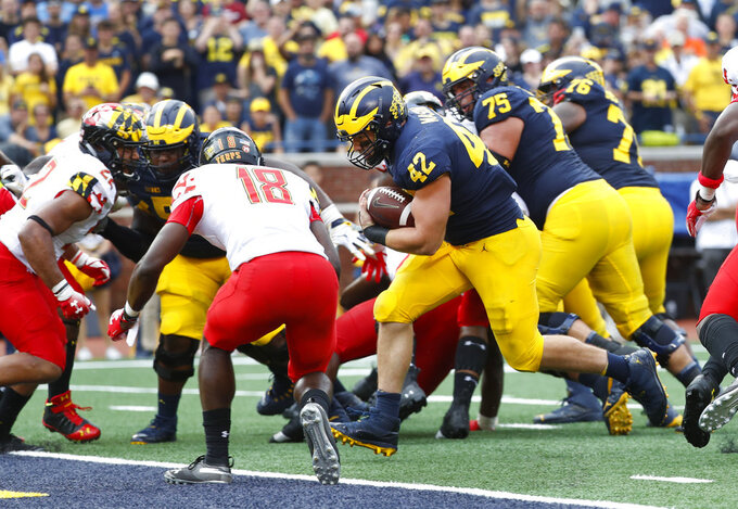 Michigan fullback Ben Mason (42) scores on a two-point conversion in the second half of an NCAA football game against Maryland in Ann Arbor, Mich., Saturday, Oct. 6, 2018. Michigan 42-21. (AP Photo/Paul Sancya)