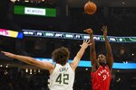 Toronto Raptors' Serge Ibaka shoots over Milwaukee Bucks' Robin Lopez during the first half of an NBA basketball game Saturday, Nov. 2, 2019, in Milwaukee. (AP Photo/Morry Gash)