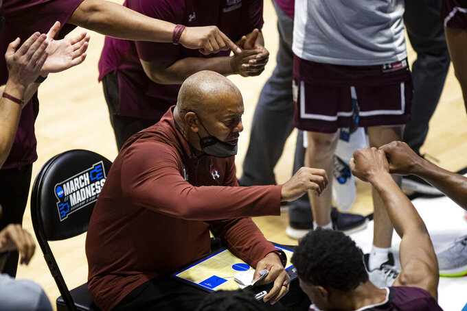 Texas Southern head coach Johnny Jones talks to his team during a timeout in the second half of a first-round game against Michigan in the NCAA men's college basketball tournament, Saturday, March 20, 2021, at Mackey Arena in West Lafayette, Ind. (AP Photo/Robert Franklin)