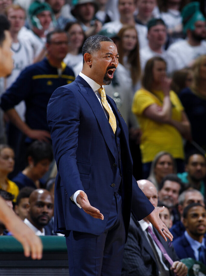 Michigan coach Juwan Howard reacts during the first half of an NCAA college basketball game against Michigan State, Sunday, Jan. 5, 2020, in East Lansing, Mich. (AP Photo/Al Goldis)